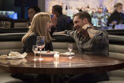 Anne Weying and Eddie Brock laughing promotional still
