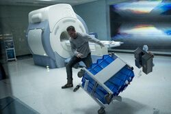 Eddie freaking out near an MRI machine promotional still