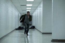 Eddie Brock running down a hallway promotional still