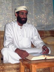 450px-Anwar al-Awlaki sitting on couch, lightened