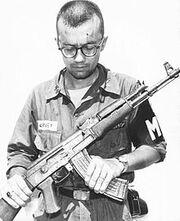220px-MP Inspects Captured AK-47 Vietnam
