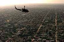 Aerial view of a US helicopter as it flies over a Mogadishu residential area JPEG