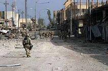 Ces Soldiers assigned to the 1st Marines, patrol south clearing every house on their way through Fallujah, Iraq, during Operation Al Fajr (New Dawn)