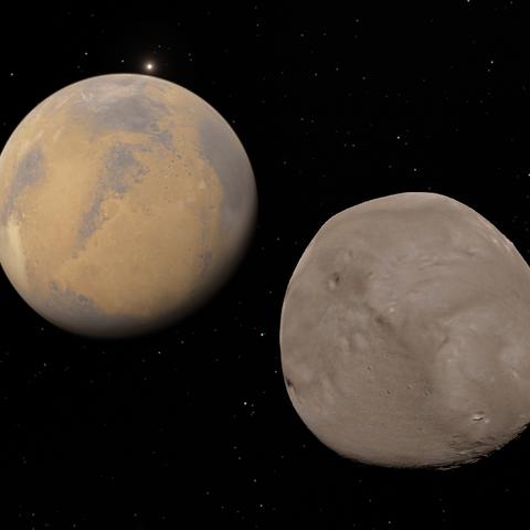 Deimos (rechts) mit Mars und Phobos (heller Punkt über Mars)