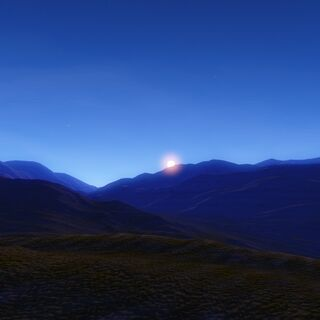 Sunset over a mountain range on the surface.