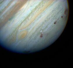 Jupiter showing SL9 impact sites
