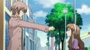Yashiro handing over something to Megumi