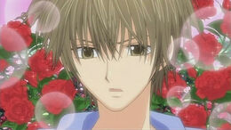 Kei with roses on the bg