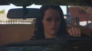 Amelia Sitting in Ferrari