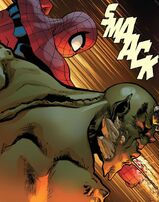 Ultimate Spider-Man punches Ultimate Green Goblin