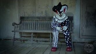 Sitting Scare Clown - Spirit Halloween-0