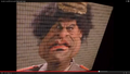 Gaddafi Spitting Image.jpg.png