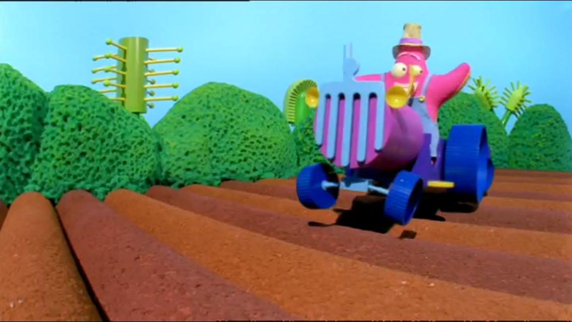 Sploshy drives her tractor through bumpy fields