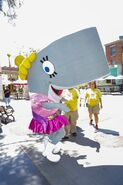 Pearl mascot costume with crew members