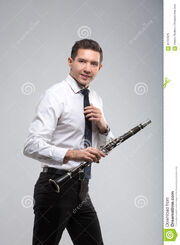 Some guy holding a clarinet