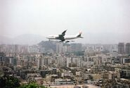 HKG Hong Kong a Jumbo Jet approaches Kai-Tak Airport