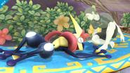 Greninja tirado al suelo junto al Entrenador Wii Fit SSB4 (Wii U)