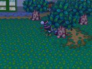 Aldeano talando un arbol en Animal Crossing City Folk