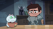 S4E18 Marco Diaz looking at the flyers