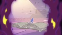 S2E28 Glossaryck sitting with his back turned