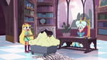 S3E17 Star Butterfly wheels a cart into the library