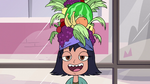 S2E32 Janna wearing a fruit hat