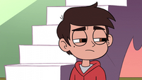 S2E11 Tiny Marco Diaz looking at giant die