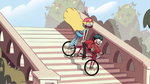 S2E5 Star and Marco riding down stairs