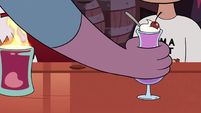 S3E22 Bartender places sundae in front of Marco