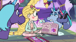 S3E21 Pamanda showing Star a book on pony law