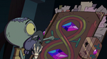 S2E35 Ludo knocking on the book of spells' front cover