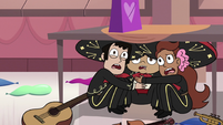 S3E25 Mariachi band hiding under a table