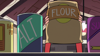 S2E24 Marco Diaz picks up a bag of flour