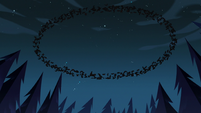 S3E12 Crows flying in a circle over the demoncism