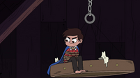 S4E18 Marco Diaz sitting on the chandelier