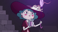 S4E23 Eclipsa carrying wand and present