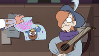 S4E24 Marco grabbing the talent show poster