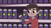 S3E15 Marco Diaz picks up a can of dragon repellent