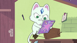S2E30 Baby holding Star's notebook of spells