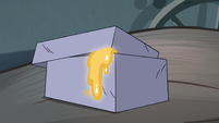 S4E23 Box with gold liquid dripping out