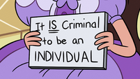 S2E36 Princess Marco holding a sign