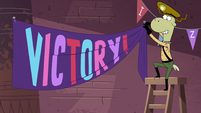 S4E35 Sean putting up a 'VICTORY!' banner