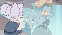 S3E33 Child Meteora looks at her glowing cheeks