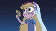 S3E9 Star Butterfly holds the spell book's remains