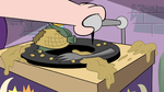 S3E4 King River's gramophone in a corn-covered mess