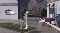 S4E3 Eclipsa's bone guitar on a guitar stand