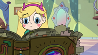 S2E25 Star Butterfly looks worriedly at her spell book