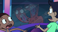 S1E10 Two-headed monster drooling on the window