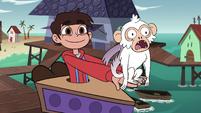 S4E2 Marco holding a white monkey