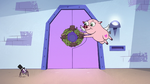 S3E26 Flying Pig hanging a Stump Day wreath